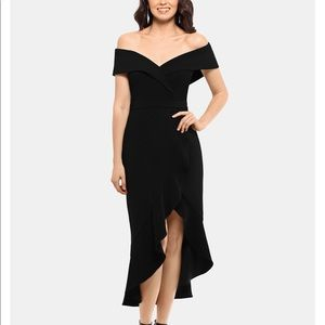A shoulder-baring stunning dress by XSCAPE